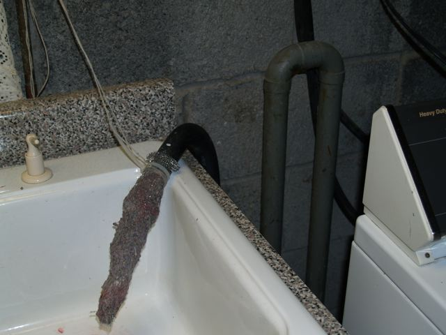 How do you keep washing machine lint from clogging your plumbing
